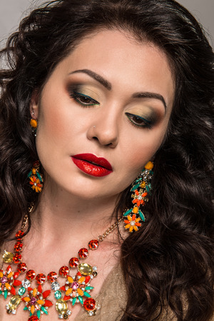 Beautiful model with golden jewelry
