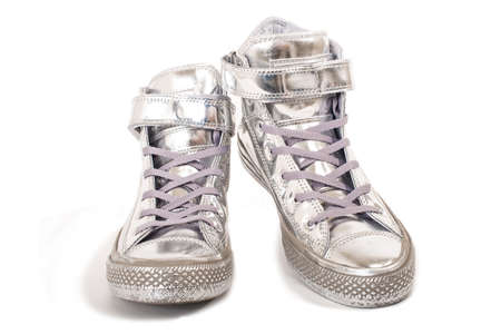 Pair of silver sneakers isolated Imagens
