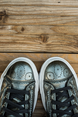 Sneakers on the wood background