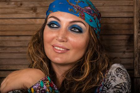 Fashion portrait of beautiful hippie young woman wearing boho chic clothes