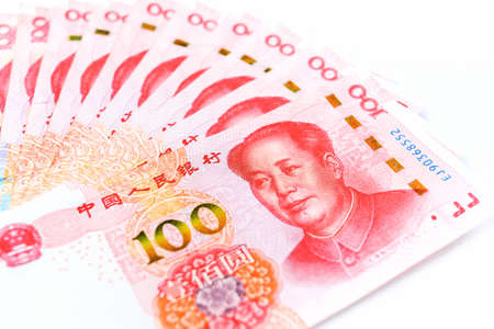 Official currency of China. Renminbi, abbreviation RMB. Yuan basic unit of the renminbi. Set of one hundred yuan close up. Chinese money. Business concept.