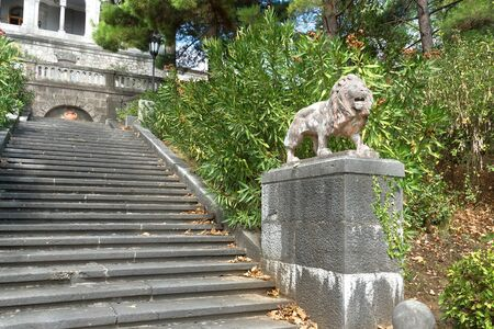 Terracotta lion of the stairs in the park at Yusupov Palace