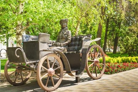 analogy: NOVOROSSIYSK, RUSSIA - MAY 08.2016: Sculpture Stranger in a carriage, the city of Novorossiysk, Krasnodar Krai
