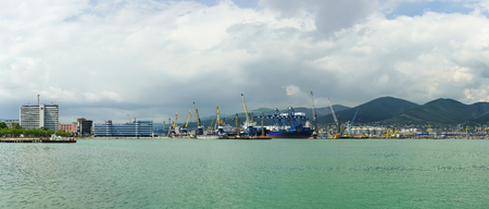 Panorama of Novorossiysk commercial sea port mountains in the background