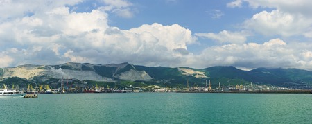 Panorama of Novorossiysk commercial sea port on the background of sky and mountains Stock Photo