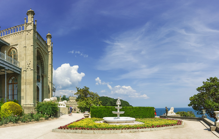 alupka: the Fountain in the flower bed near the South entrance of the Vorontsov Palace. Yalta, Alupka, Crimea, Russia