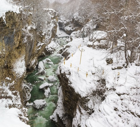 shroud: KAMENNOMOSTSKIY, ADYGEYA, RUSSIA - January 29.2017: Equipped with a reliable protection system guided tour on the territory of the hadzhohskaya tasnina canyon, a scenic gorge of the White river