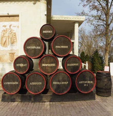 STANITSA TAMAN, TEMRYUK DISTRICT, KRASNODAR KRAI, RUSSIA - January 04.2017: Stylized and stacked pyramid of wine casks with the inscription varieties near the wine Museum Editorial