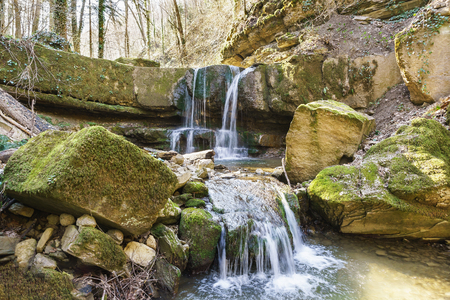 The waterfall on the left tributary of the mountain river Kaverze in the Krasnodar region. Russia