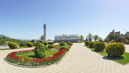 Gelendzhik, Krasnodar Krai, Russia - April 29.2017: a Panoramic view of the stele with the inscription hero City of Gelendzhik and the spring flower beds with tulips at the entrance to the city