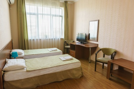 lodgings: The bright hotel twin rooms of economy class. Budget furniture Stock Photo