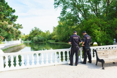 duty belt: Sochi, Krasnodar Krai, Russia - June 06.2017: Two police officers follow the rule of law around the pond in the dendrological Park Southern culture. Patch Police Editorial