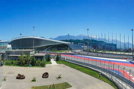 Sochi, Russia - June 05.2017: the building of the Tennis Academy Adler-arena Ice sports Palace iceberg, the formula 1 track with bleachers and other facilities of the Olympic Park in Sochi Editorial