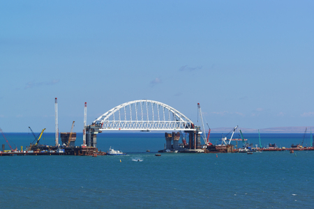 Russia, the Kerch Strait - September 02.2017: Construction of road and railway bridges across the Kerch Strait. The navigable span of the railway arch