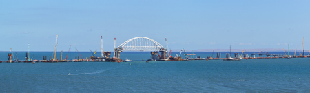Russia, the Kerch Strait - September 02.2017: Panorama of construction of road and rail bridges across the Kerch Strait. The arched span of the railway bridge over the navigable part of the Strait