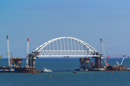 Russia, the Kerch Strait - September 02.2017: 227-metre arched span railway bridge under construction across the Kerch Strait on the navigable part of the Strait
