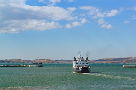 light duty: Russia, the Kerch Strait - September 02.2017: Old car ferry Yeysk light-duty cargo vehicles and passengers departing from port Kavkaz to port Krym