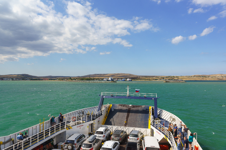 Russia, the Kerch Strait - September 02.2017: Loaded car ferry Major Capiche swims to the port of Crimea