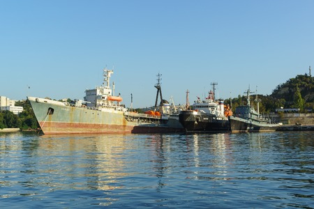 soviet flag: Russia, Crimea, Sevastopol - September 03.2017: the Average sea tanker Koyda, rescue tugboat Shakhter and fire the ship pzhs-123 in the Quarantine Bay of Sevastopol