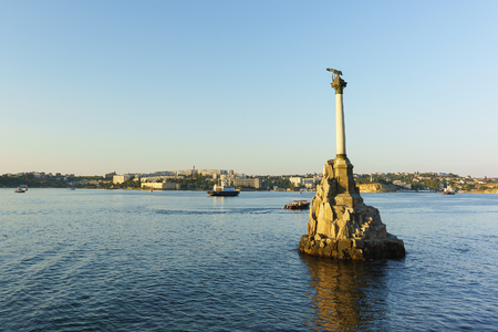 Russia, Crimea, Sevastopol - September 03.2017: monument to the scuttled ships in the Sevastopol Bay. At sea, sailing ships. Sunset Editorial