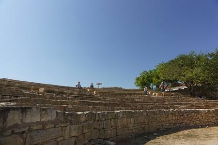 Russia, Crimea, Sevastopol - September 04.2017: Tourists sitting in the ancient amphitheatre in Chersonesos Tauride Sunny day