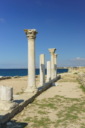 Russia, Crimea, Sevastopol - September 04.2017: Marble columns of ancient Greek Basilica of the VI-X centuries on the shores of the Black sea in Chersonesus Tavrichesky. Sunny day