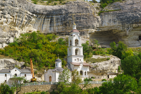 Belfry of the Holy assumption Orthodox cave monastery in the Crimea, located in the natural boundary of Mariam-Dere (Marias Gorge) near Bakhchisarai. Stock Photo