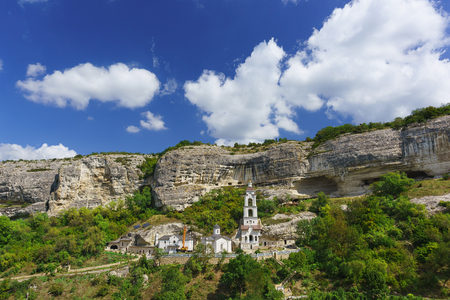 The largest in the Crimea by the number of inhabitants of the Holy Dormition cave Orthodox monastery located in the natural boundary of Mariam-Dere (Marias Gorge) near Bakhchisarai.