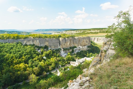 Landscape view from above on the natural boundary of Mariam-Dere (Canyon of Maria), Holy assumption Orthodox cave monastery in the Crimean mountains. Bakhchisaray