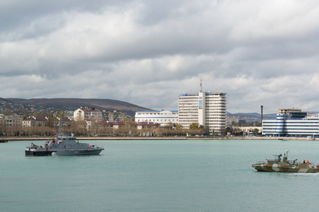 Russia, Novorossiysk - October 28.2017: Anti-sabotage and patrol boats in the waters of Novorossiysk commercial sea port. Berths are bulk carriers. Cloudy autumn day Editorial