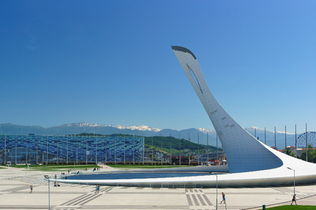 Russia, Sochi, Krasnodar region-June 05.2017: Olympic Park on a warm summer day amid snow-capped mountain peaks