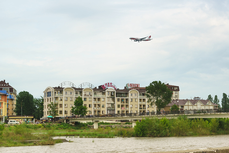 Russia, Sochi, Krasnodar region-June 07.2017: the plane of Red Wings airline comes to land above the hotel in the resort of Adler. Cloudy day in early summer