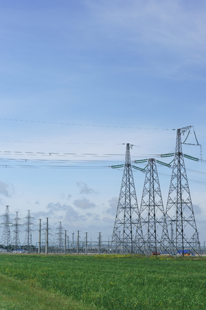 Power transmission line supports and transformer substation on Taman Peninsula to provide electricity to the Crimean bridge infrastructure. Vertical frame