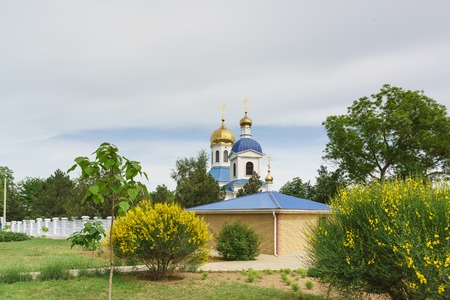Domes of the Cathedral of the Dormition in the city of Kerch on the street Ulyanov. Cloudy spring day