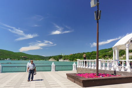 Russia, Krasnodar region, Novorossiysk, Abrau-Durso village-June 12, 2018: Sunny day off on the embankment of the picturesque mountain lake Abrau