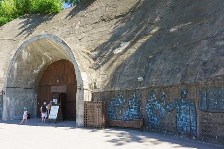 Russia, Krasnodar region, Novorossiysk, Abrau-Durso village - June 12, 2018: Tourists enter the company store Grotto, the walls of which are decorated with graffiti artist Andrei Mitenev Editorial