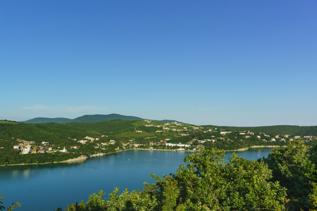 Top view of beautiful lake Abrau and a village of Abrau-Durso Novorossiysk city district. Sunny summer day