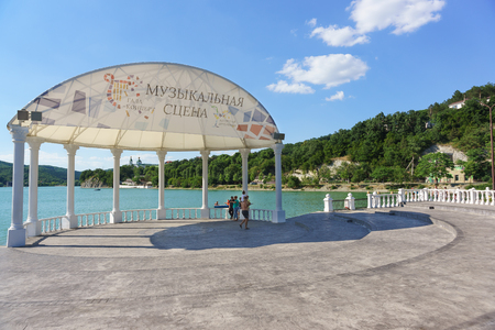 Russia, Krasnodar region, Novorossiysk, Abrau-Durso village-June 12, 2018: lake Abrau Embankment. The inscription in Russian Music scene, Gala-concert, Antique party. Sunny summer day Editorial