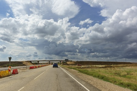 Cloudy sky over the road under construction Tavrida in the Crimea. Two-level decoupling