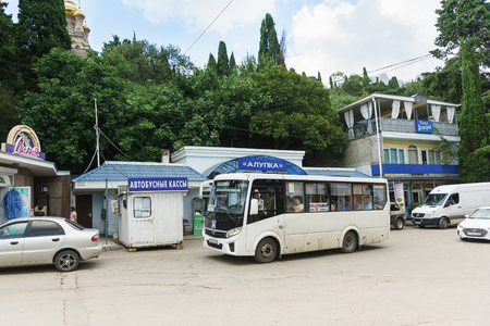 Alupka, Yalta, Crimea, Russia-September 08, 2018: the Passing bus Yalta-Katsiveli is at the bus station Alupka. The inscription in Russian Bus ticket Office