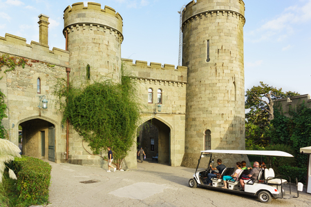Alupka, Yalta, Crimea, Russia-September 12, 2018: Tourists go on a car tour of the Park Vorontsov Palace, built in the early XIX century. Sunny summer day