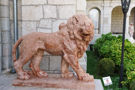 Koreiz, Yalta, Crimea, Russia-September 13, 2018: Terracotta lion near the main entrance to the Yusupov Palace. The inscription in Russian  it is forbidden to Touch the sculpture