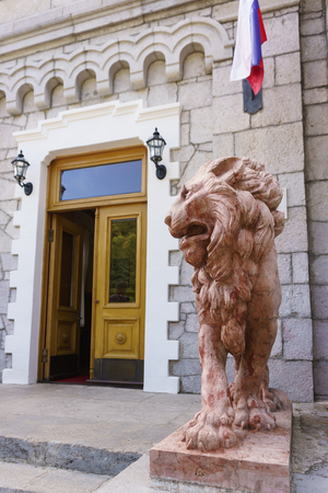Koreiz, Yalta, Crimea, Russia-September 13, 2018: Terracotta lion by architect A. Moriji at the door of Yusupov Palace