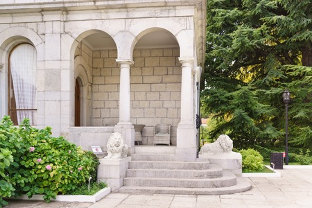 Koreiz, Yalta, Crimea, Russia - September 13, 2018: the entrance to Yusupovs dining room is Guarded by sculptures of white lions. Sunny summer day