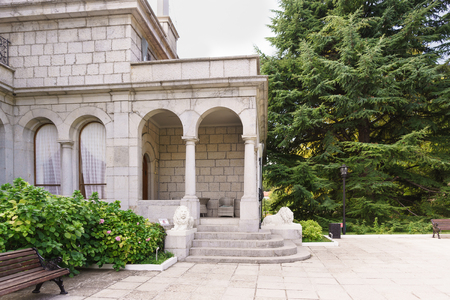 Koreiz, Yalta, Crimea, Russia - September 13, 2018: the porch of the Yusupov Butlers dining room Guarded by sculptures of white lions. Sunny summer day