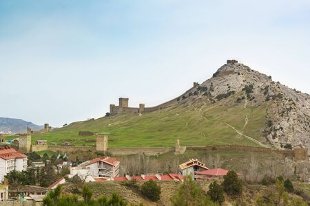 Landscape view of the old Genoese fortress in the resort town of Sudak in the Crimea. Cloudy day in early spring