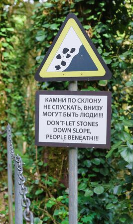 a Warning sign banning throwing down stones on a tourist trail in the yew-Box grove, Khosta. The inscription in Russian Stones on the slope do not descend. there may be people down there!