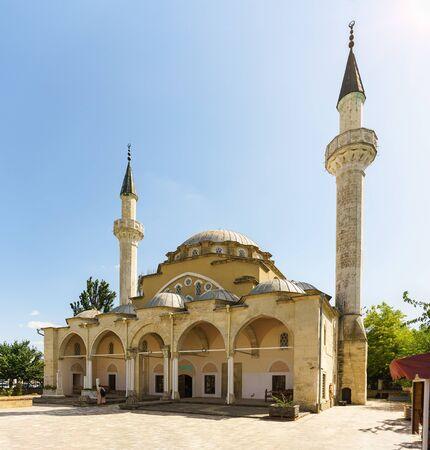 The old multi-domed Juma Khan-Jami mosque in Yevpatoria. Sunny summer day
