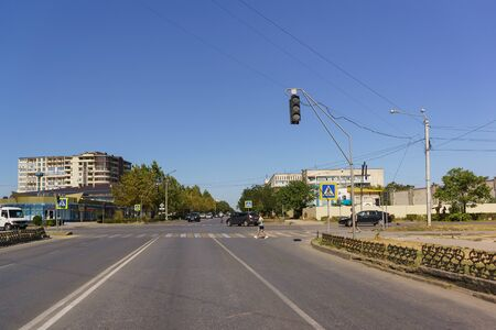 Evpatoria, Crimea, Russia-September 10, 2019: View from a car stopped at a traffic light at the intersection of Pobedy Avenue and Internatsionalnaya street. People walk on a pedestrian crossing Redakční