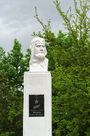 Fadeevo, Krasnodar region, Russia-may 06, 2019: Monument to the Hero of the Soviet Union fighter pilot Vadim Ivanovich Fadeev on a cloudy day. The inscription in Russian  Hero Fadeev V. I.